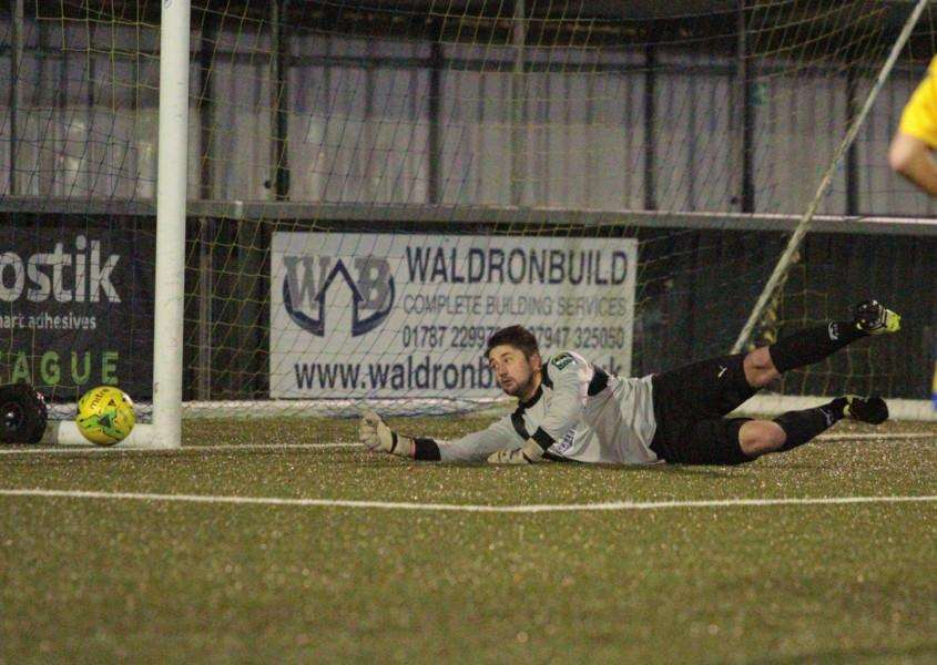 KEY SAVE: Josh Pope made his low save to deny AFC Sudbury's Max Booth an early opener in Tuesday's pleasing Soham win