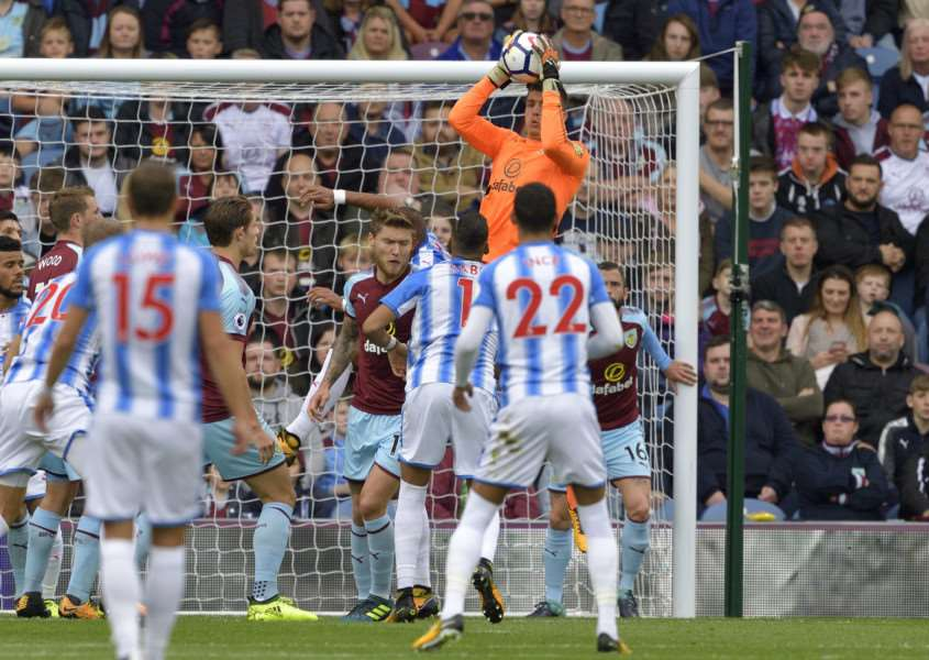 RISING HIGH: Pope collects against Huddersfield earlier this season. Picture: Burnley FC/Phill Heywood