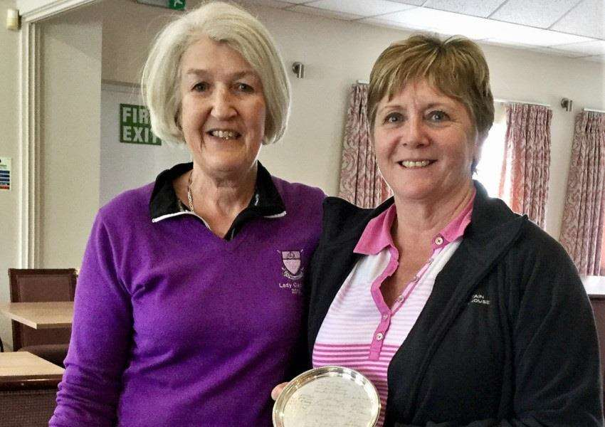 Stowmarket Ladies' captain Anne Fenning presenting Bev Waspe with the Pat Grayson Past Captains' Plate for 2018