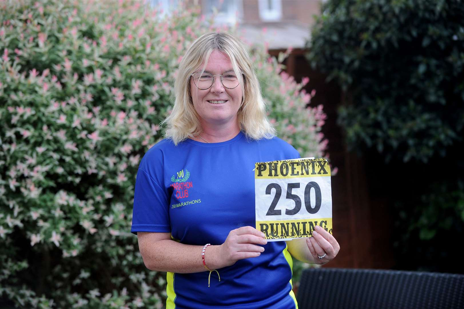 Melanie Sturman with the special number she was given for Saturday's marathon	Picture by Mecha Morton