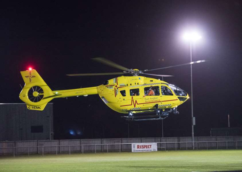 EMERGENCY: The Air Ambulance takes off from the grass pitch at The New Croft on Friday