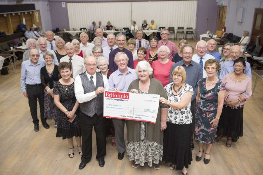 Peter and Jackie Fairweather, organisers of the Tea Dance at British Sugar Social Club, present a cheque to Maurice Rutter Chairman and Glynis Bannister club secretary Bury St Edmunds branch of Parkinson's UK.'Picture: Mark Westley