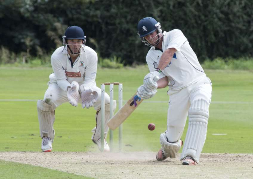 DERBY WINNERS: Mildenhall's Steve Taylor plays a shot under the watchful eye of Worlington wicket-keeper Richard Ford.