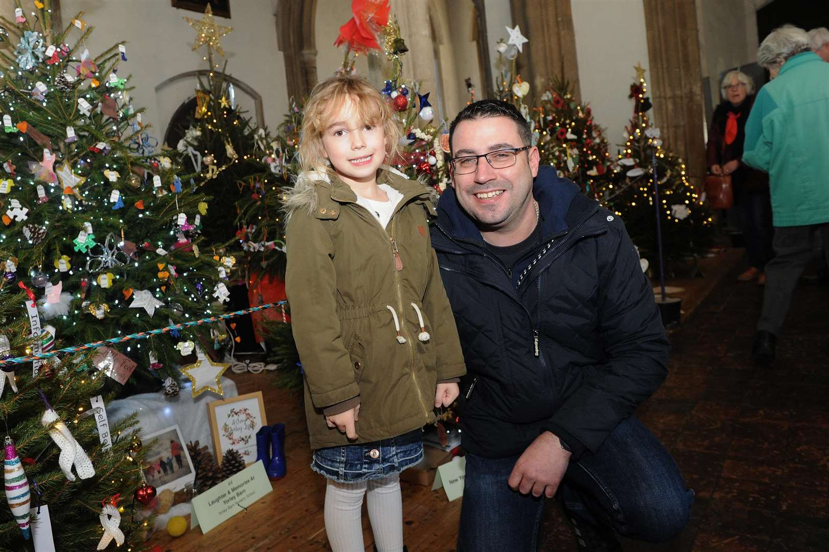 A Christmas tree festival has been staged at St Peter's, organised by Sudbury Rotary Club...Pictured: Jason and Paige (6) Lavender visiting the festival...PICTURE: Mecha Morton. (5877126)