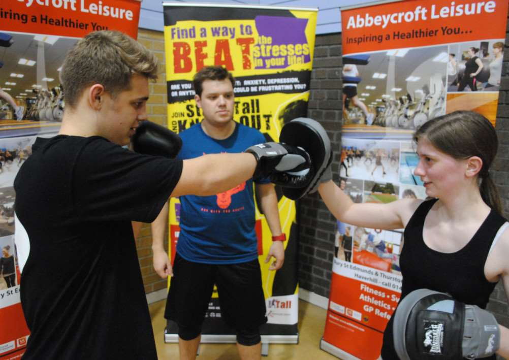 Participants Reece Crabbe and Charlotte Palmer with instructor Craig Turner at Bury St Edmunds Leisure Centre, taking part in a new project to help young people with depression and anxiety. ANL-151102-152445001