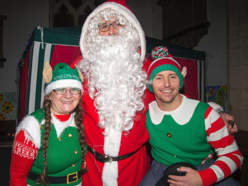 Father Christmas with his two elves at last year's fair.