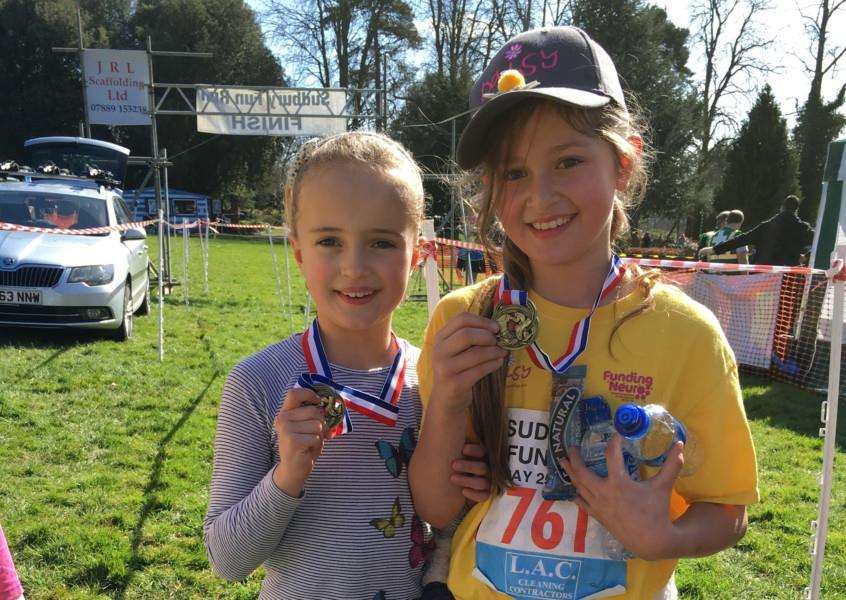 Sudbury Fun Run - 8 yr old Evie Cook and 9 yr old Amelie Kingston who walked the 5 miles with their mums and raised over �700 for the Doing It For Daisy Fund ANL-160329-114350001
