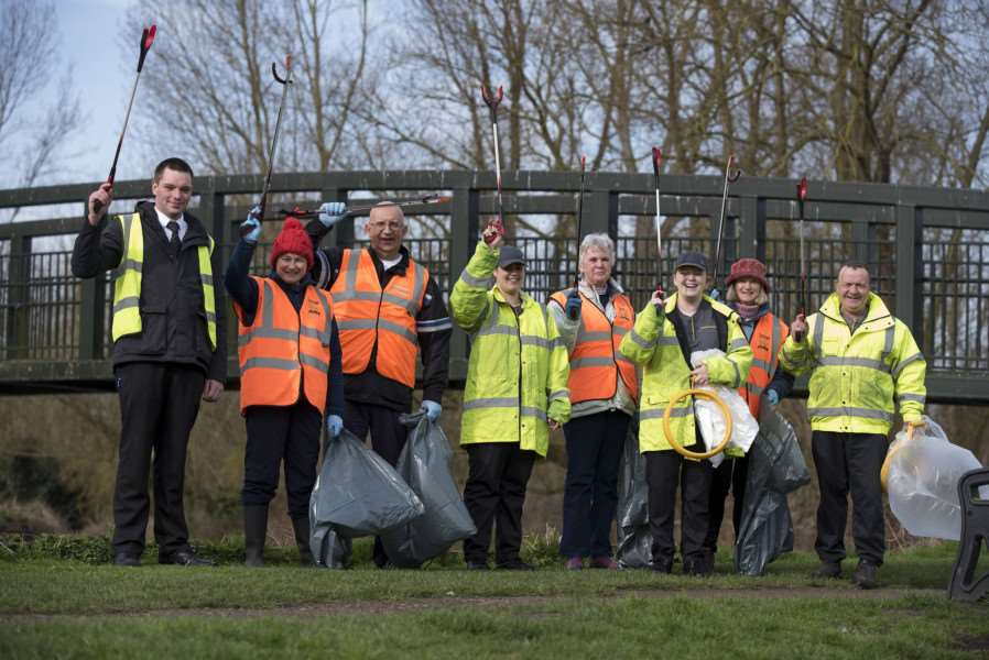 Great British Spring Clean at the bridge over Lark at Jubilee Field with a team of McDonalds staff and parish councillors