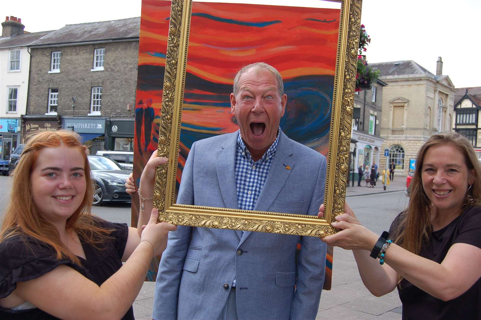 Cllr Robert Everitt, West Suffolk Council's Cabinet Member for Families and Communities poses for his own scream, to highlight mental health awareness. He is pictured with Sasha and Jordanna Campbell of Fine Not Fine. (13819999)