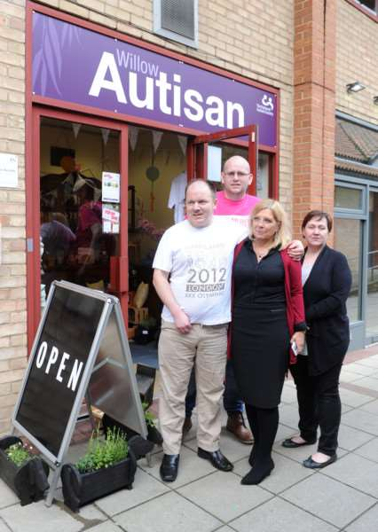 The National Autistic Society set up a pop-up shop in Mildenhall ''Pictured: Simon Lancaster (Lives in one of the services), Tony Spillett (Team Leader), Chris Taylor (Manager of community services) and Alison Bird (Support Worker) ANL-160404-154006009