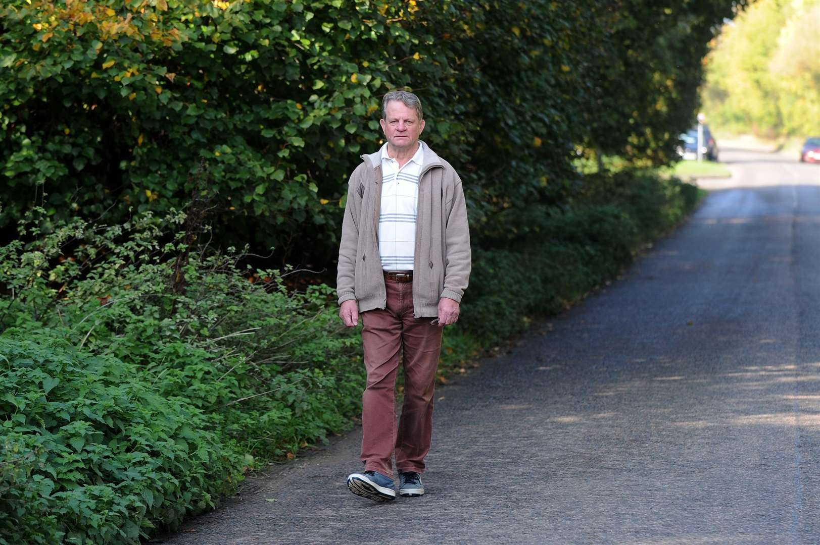 Alan Allum has raised concerns about the road near his house which does not have a footpath..Mr Allum walks along Middleton Road every day to walk his dogs, but said the lack of path and poor visability of road signs poses a constant danger for pedestrians......PICTURE: Mecha Morton... .. (4821412)