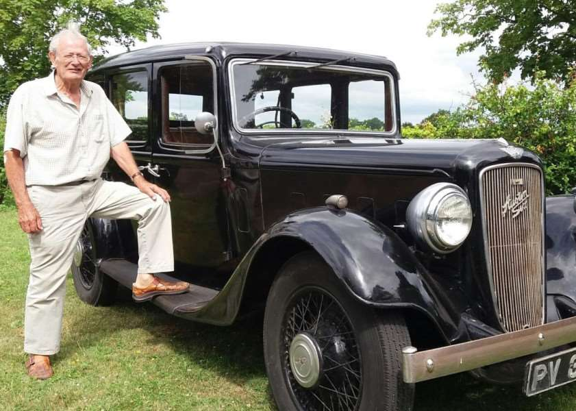 Pat Morton with the Austin taxi that once carried King George VI and Winston Churchill.