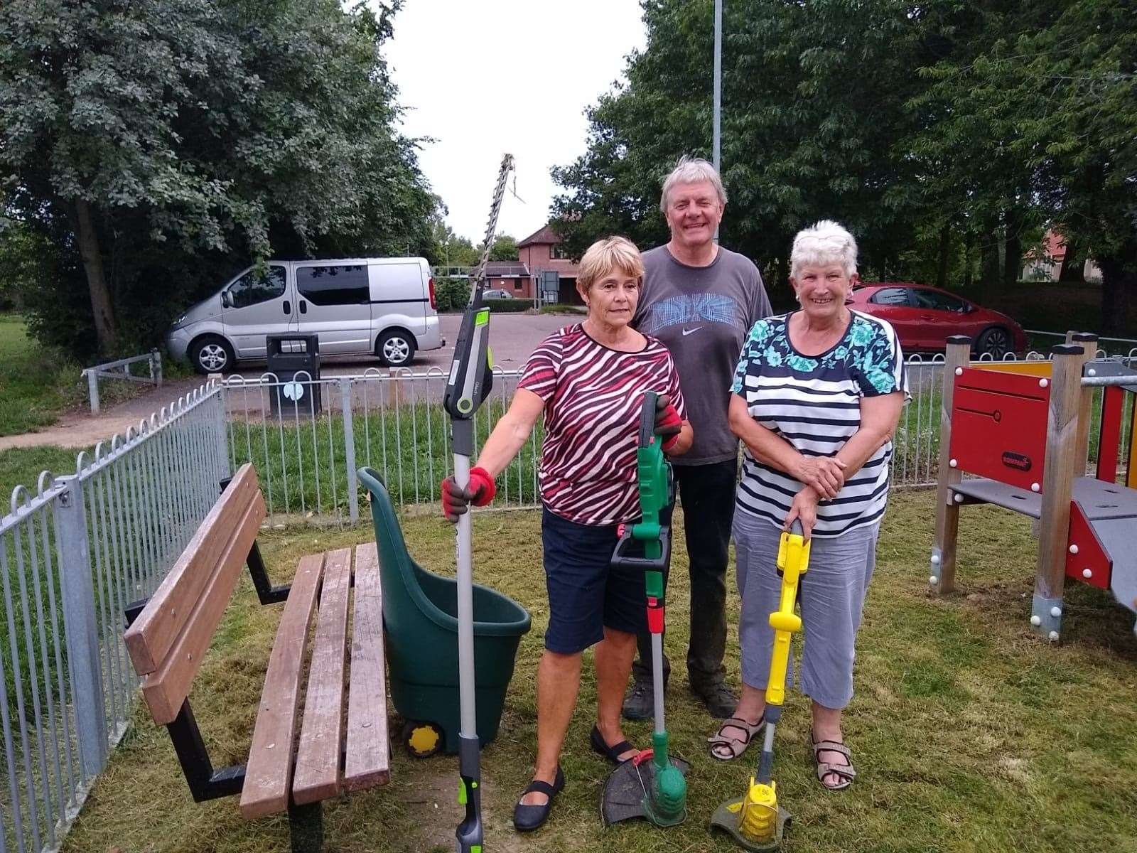 Moreton Hall residents Pauline Tarbit, Mike Moody and Linda King take action at Heldhaw Road play area.