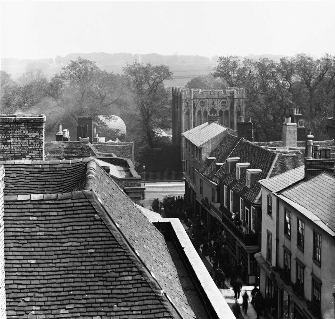 View down Abbeygate Street, Bury St Edmunds, with balloon in the AbbeyGardens. From the Spanton Jarman collection (5586213)
