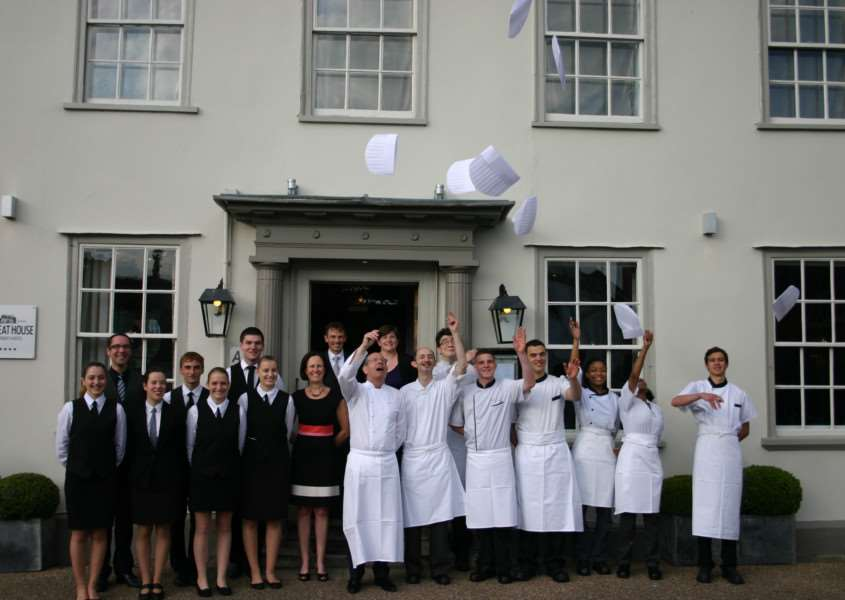 Staff at the Great House in Lavenham celebrate being named the 26th best restaurant outside London in a poll by Square Meal magazine. ANL-150728-103040001