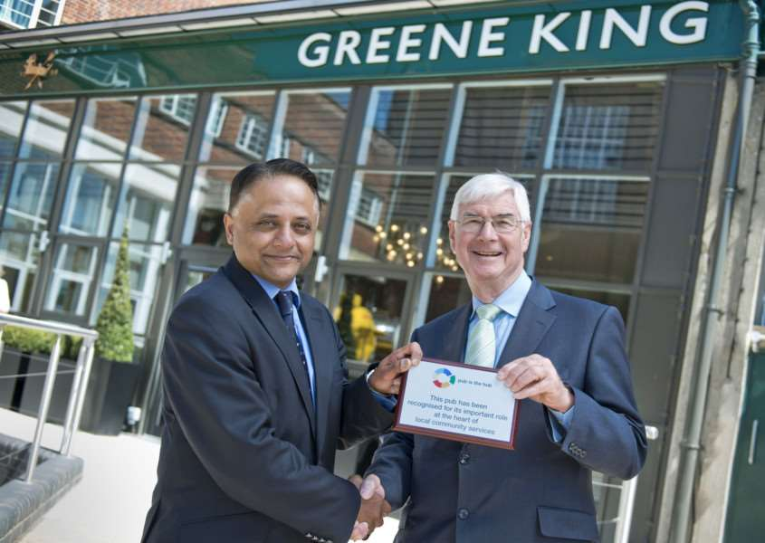 Rooney Anand, Greene King's chief executive, presents �15,000 to John Longden, chief executive of Pub is The Hub