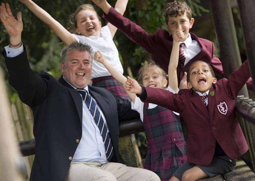 South Lee School headmaster Mervyn Watch and pupils celebrate the inspection result