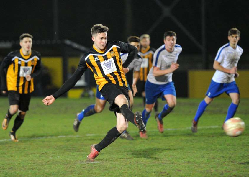 LEADING MARKSMAN: Josh Mayhew tucks away his penalty during Stowmarket's big victory