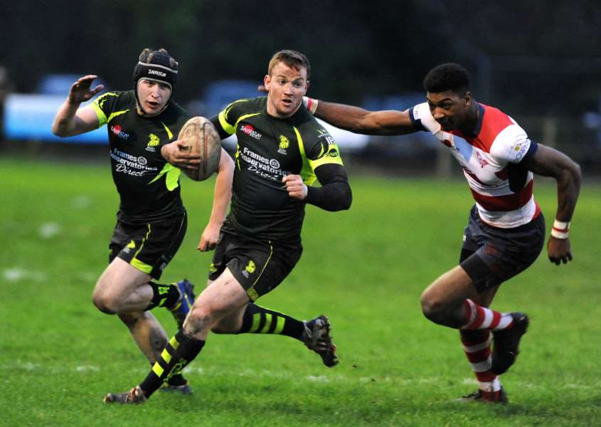 FAST FEET: Sam Goatley leads the charge during Bury Rugby Club's victory over Dorking at the weekend.