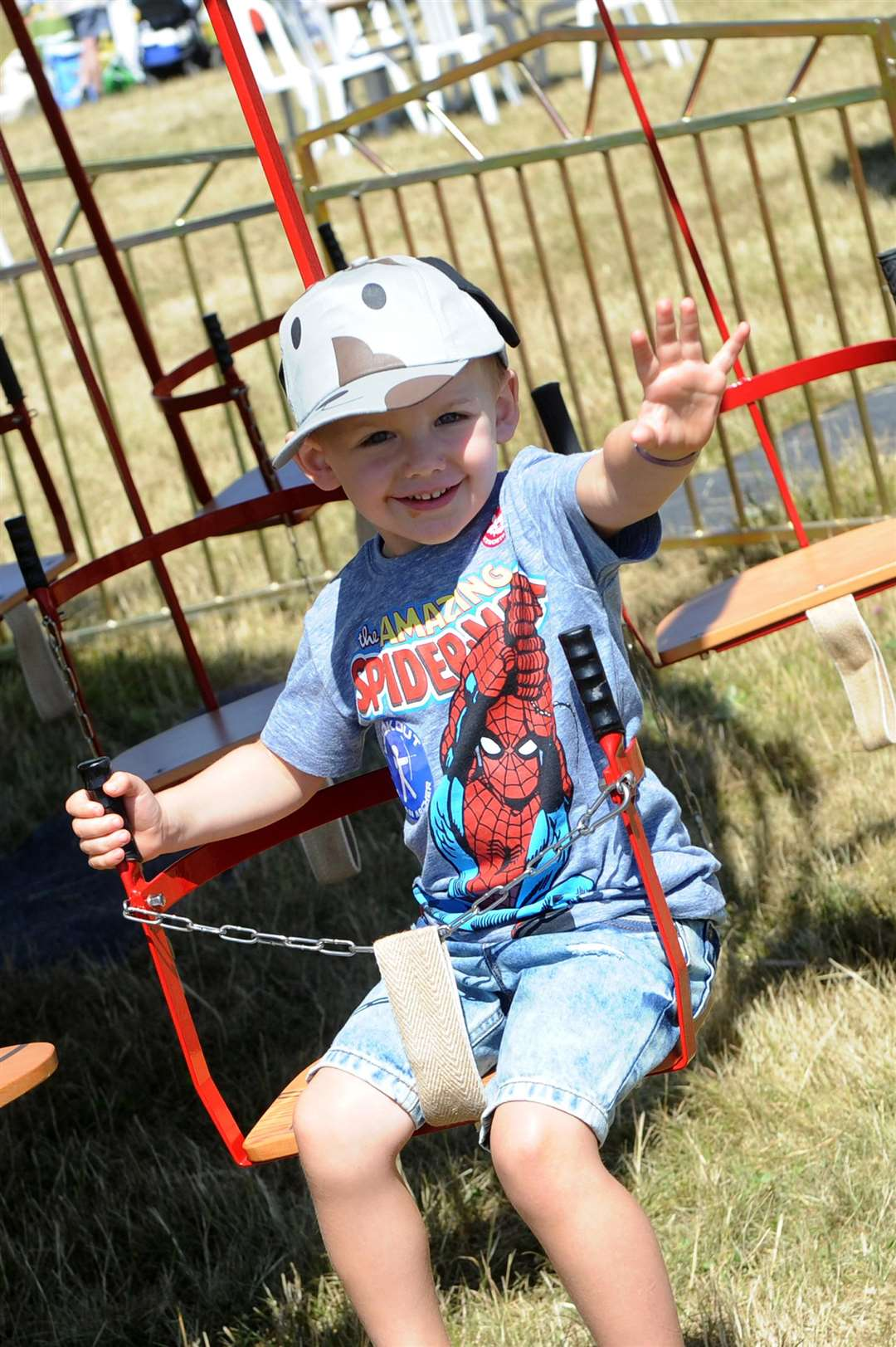 Charlie Wood, three, having a good time on the carousel swing. Picture: Mecha Morton