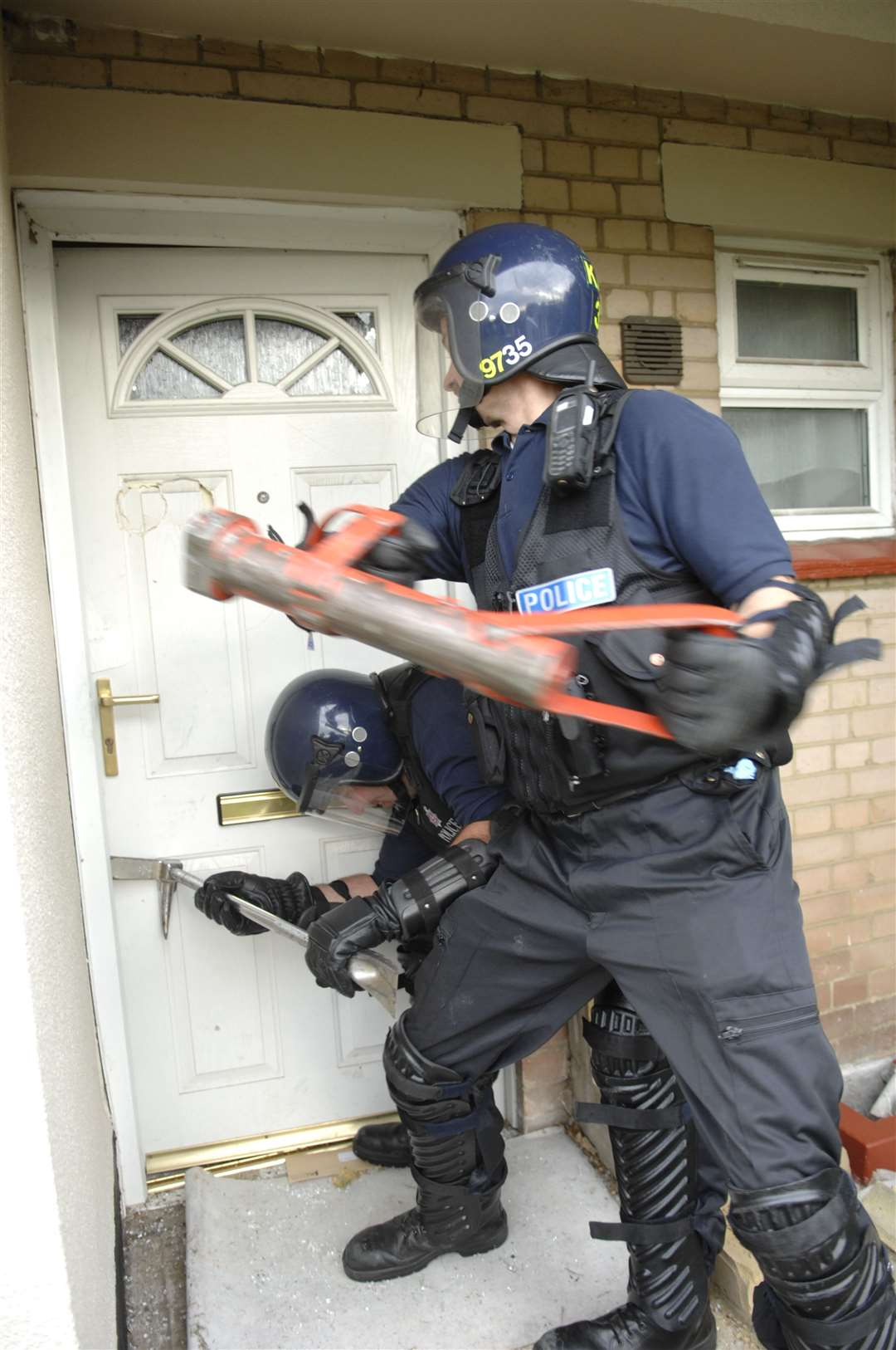 Police conduct a drugs raid at a property. This photo is for illustrative purposes only.