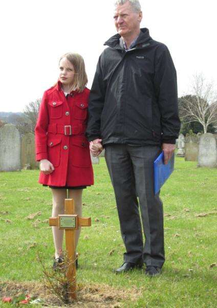 Annie Dureall's grandson Colin Jamieson stands at her grave with his granddaughter Jenna Stevens ANL-160104-162752001