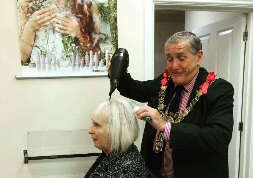 HAIR TODAY: Sudbury mayor Jack Owen tries his hand at styling Val'Mumford, Fanboo's longest-established client, who has visited the salon'nearly every Saturday for the past five years. ANL-151013-094818001