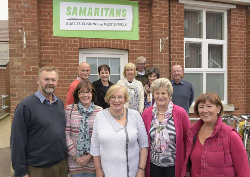Jenny Vereker, centre front, with volunteers at Bury's new Samaritans' headquarters ANL-151014-180104009
