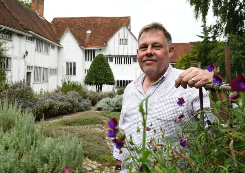 Lavenham, Suffolk. Lavenham Open Gardens event to raise money for St Nicholas Hospice. Pictured is Jonathan Hill in his garden at the Priory on Water Lane. ''Picture: MARK BULLIMORE