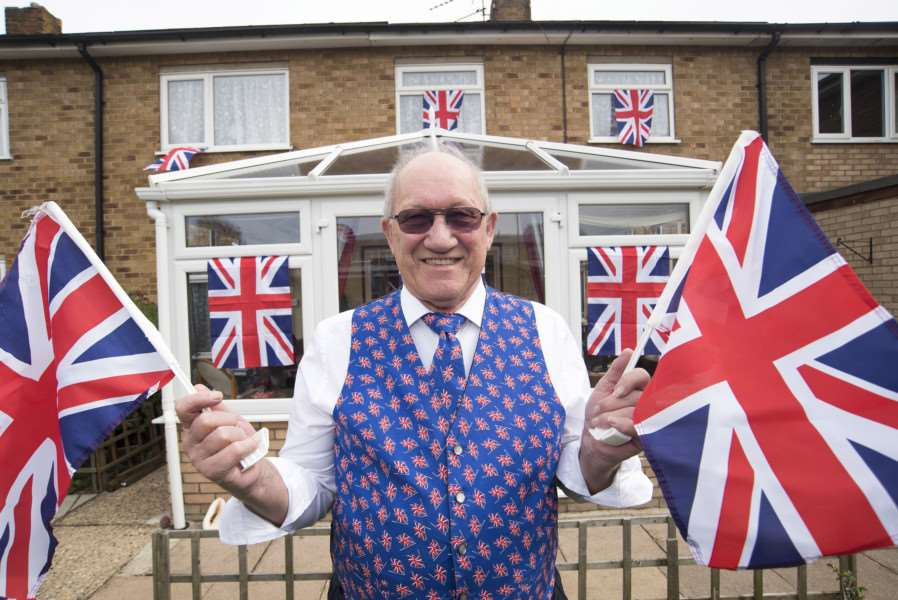 Gordon Jones celebrates the Queen's 90th by flying Union Jacks all around his house and garden.'Picture Mark Westley
