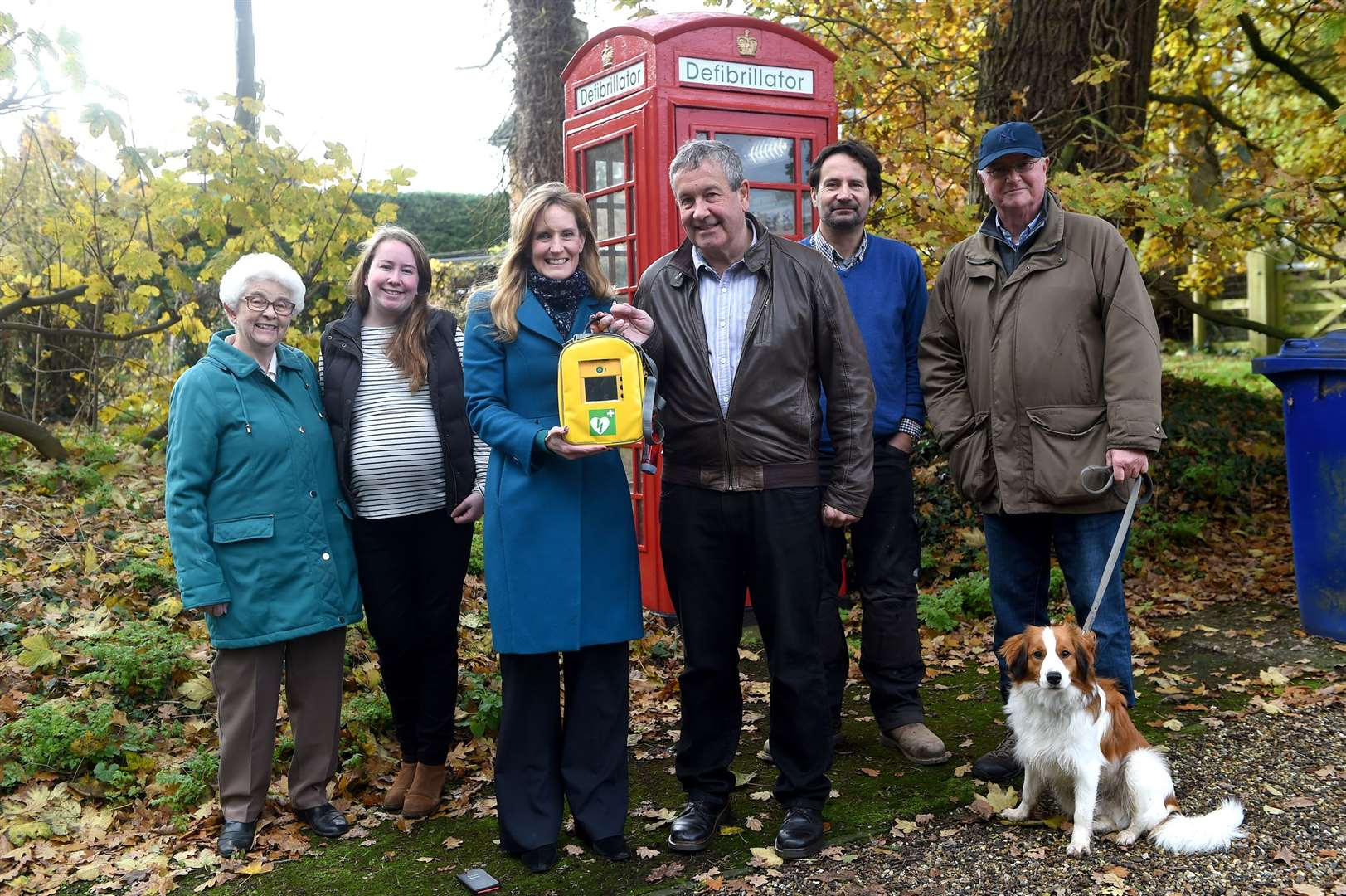 A red telephone box in Hawstead has ben converted into house defibrillator..Pictured: Ethel Lebbon (resident), Lucy Brewis (resident), County Cllr Karen Soons, Parish Cllr Henry Brewis, Clive Robinson (Resident) and John West (Chairman of Parish Cllr)...PICTURE: Mecha Morton .... (21938949)
