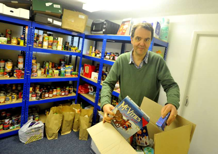 Andrew Stewart-Darling packing food hampers to give out to people from the Stour Valley Vineyard Church. ENGANL00120131223141225