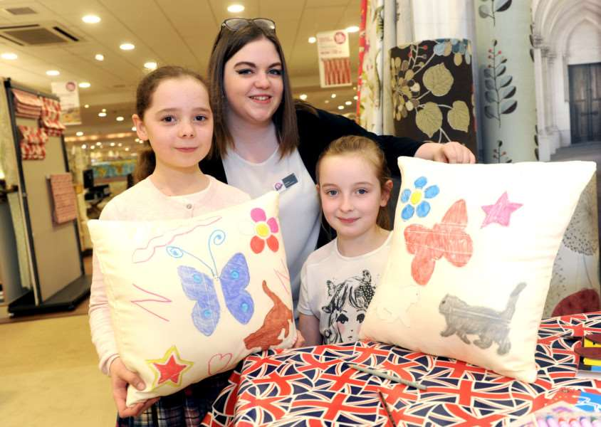 Glasswells Big Birthday Weekend''Pictured: Nicole Nydam (9) and Hannah Boreham (9) with Sophie Cooper (Sales Adviser) designing their own cushions ANL-160205-150118009