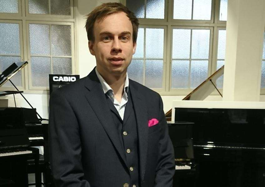Simon Pollard, managing director of Miller's Music, in its Cambridge Showroom