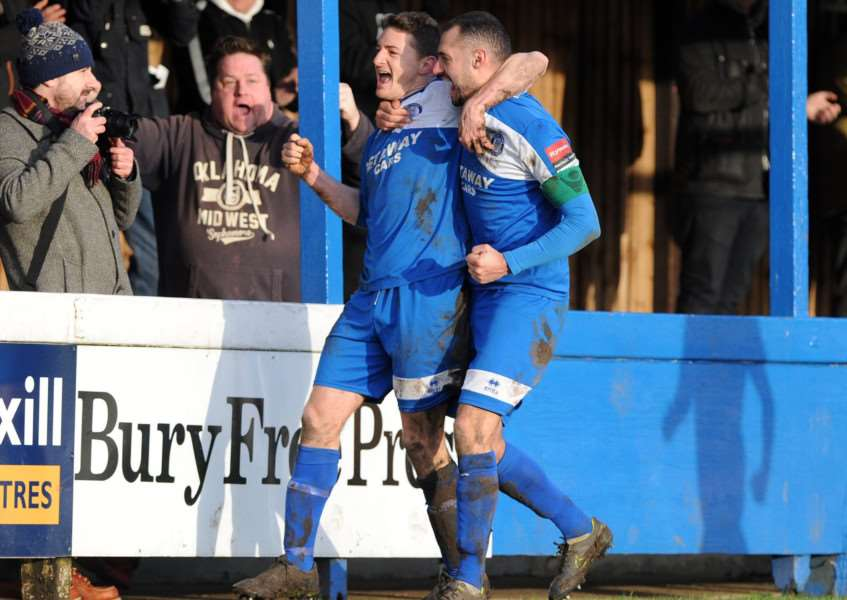 BACK ON TRACK: Ollie Hughes takes the home fans' adulation with captain Bradley Barber after the striker scored the equaliser on Monday