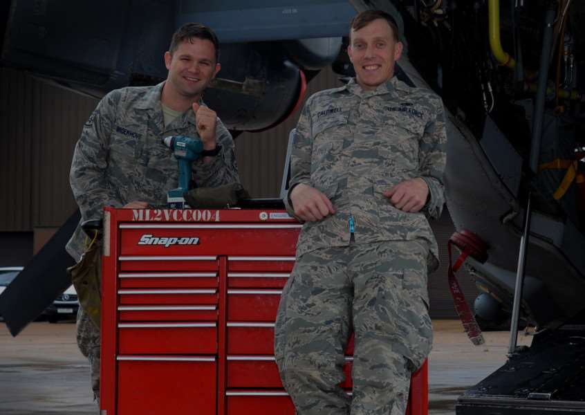 US Air Force Staff Sgt Blake Broekhove (left) and US Air Force Staff Sgt Scott Caldwell, 352nd Special Operations Maintenance Squadron CV-22 Osprey crew chiefs, stands near a CV-22 while on the flightline at RAF Mildenhall. Caldwell and Broekhove put their military training skills to work by performing CPR as a team on an injured community member. U.S. Air Force photo by Senior Airman Victoria H. Taylor. ANL-150914-122420001