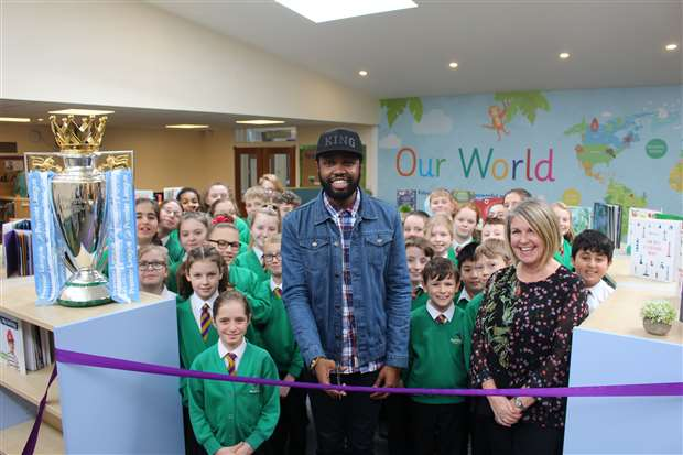Poet Karl Nova officially opens Burton End Primary Academy's new library during his visit to the school. Picture by Gooderham PR