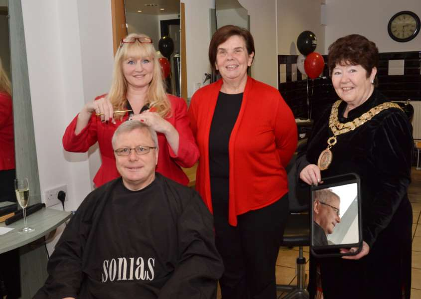 Gerry Kiernan gets his hair cut by Sonia Humphrey, owner of Sonia's Hair and Beauty, 25 years after being her first ever customer. With them are Fiona Pilcher and the mayor of Haverhill, Cllr Betty McLatchy. Picture: David Doughty ANL-151117-162350001