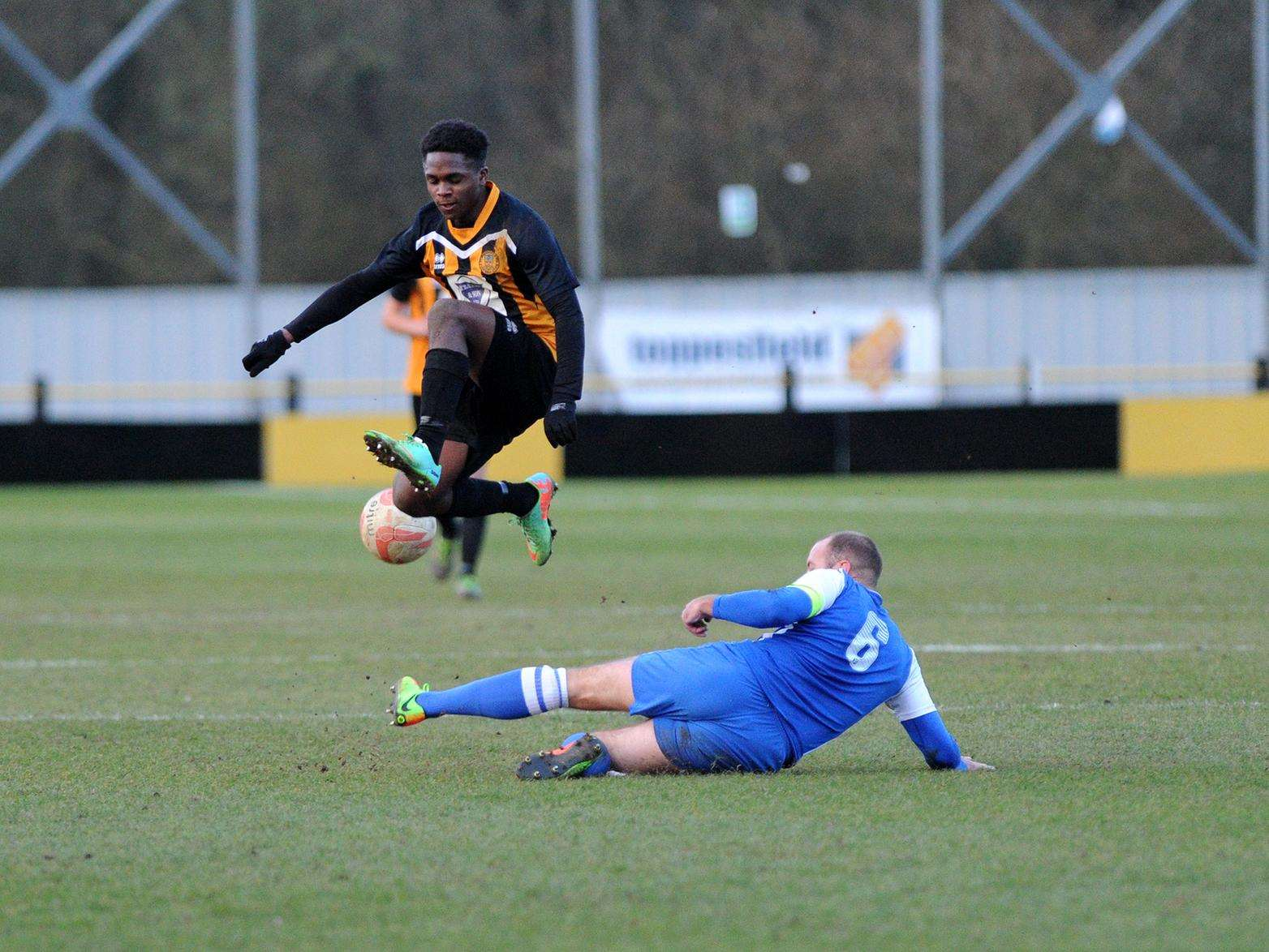 Stowmarket Town's Amar Lewis jumps a tackle in the home game with Coggeshall Picture: Mecha Morton