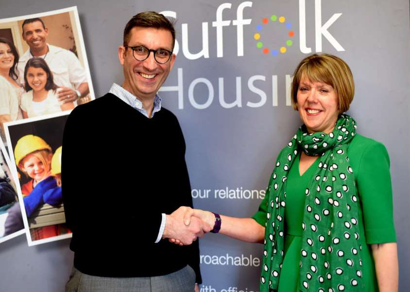 Ian Winslet hands over to Suffolk Housing's new chief executive Sue Philp.