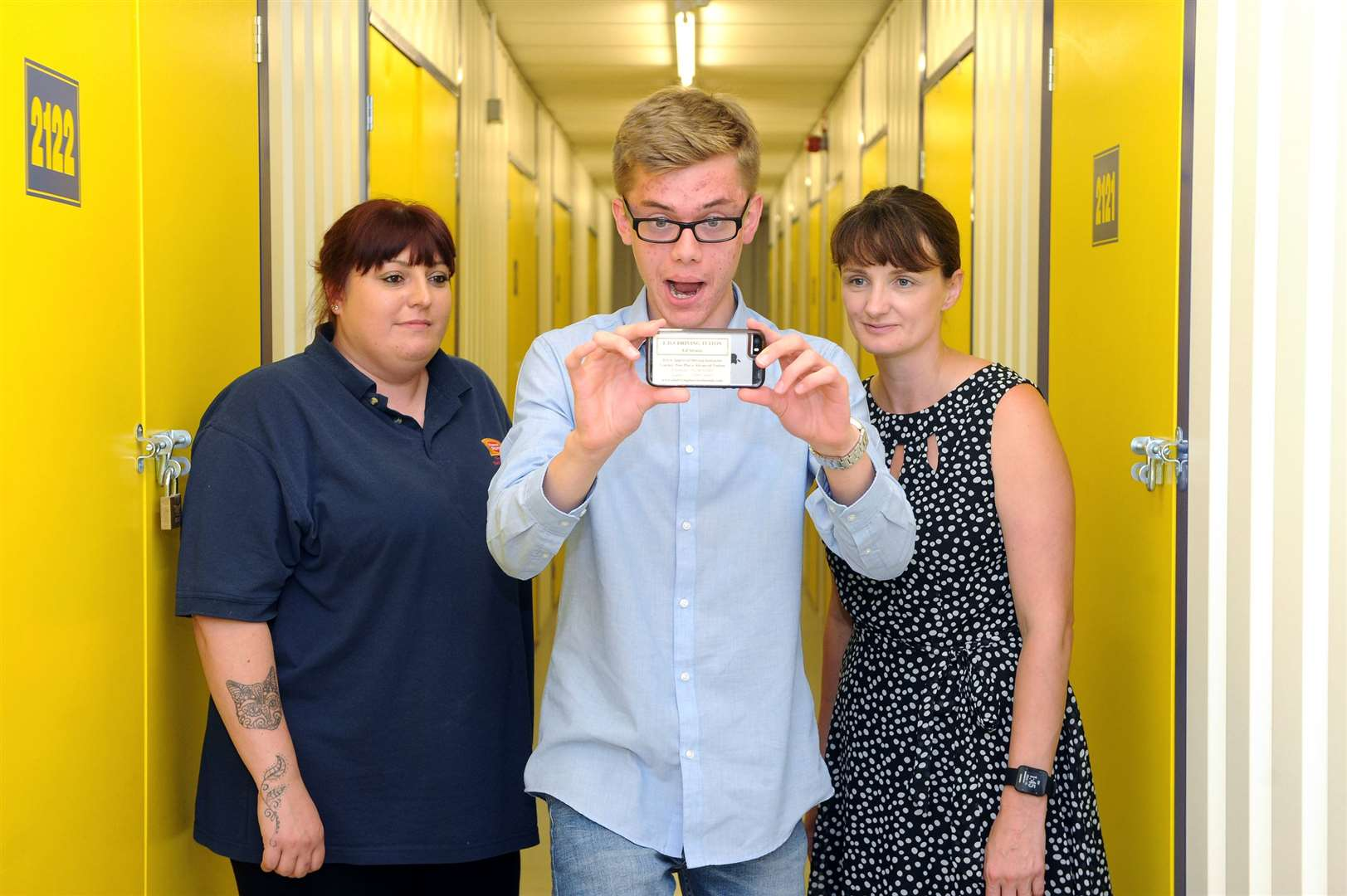 Hana Sculpher, assistant manager at Homestore, student Daniel Bellamy, who shot the film on his iPhone, and Liza Ollett, subject leader for film studies at King Edward VI School. Picture by Mecha Morton.