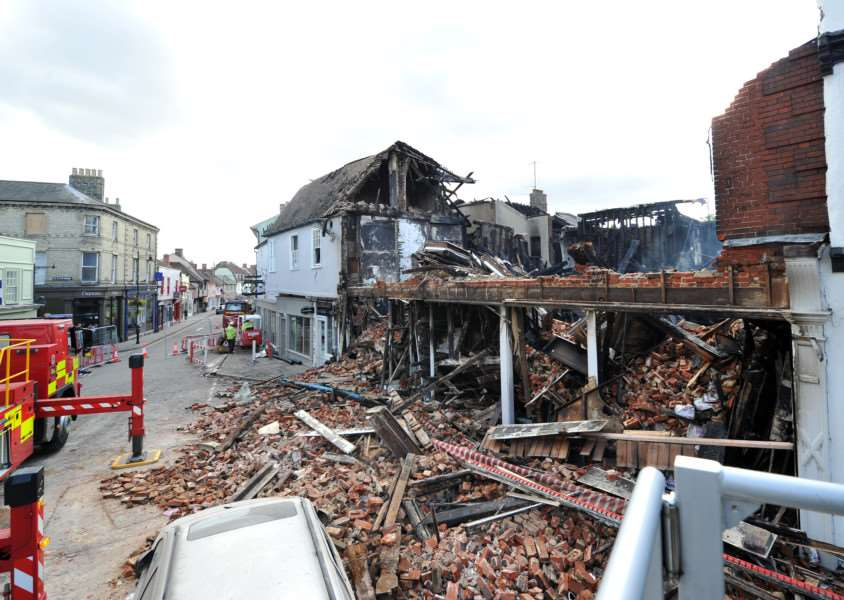 THE AFTERMATH: Fire ripped through shops and properties in Friars Street, Sudbury last night. ANL-150709-170856009