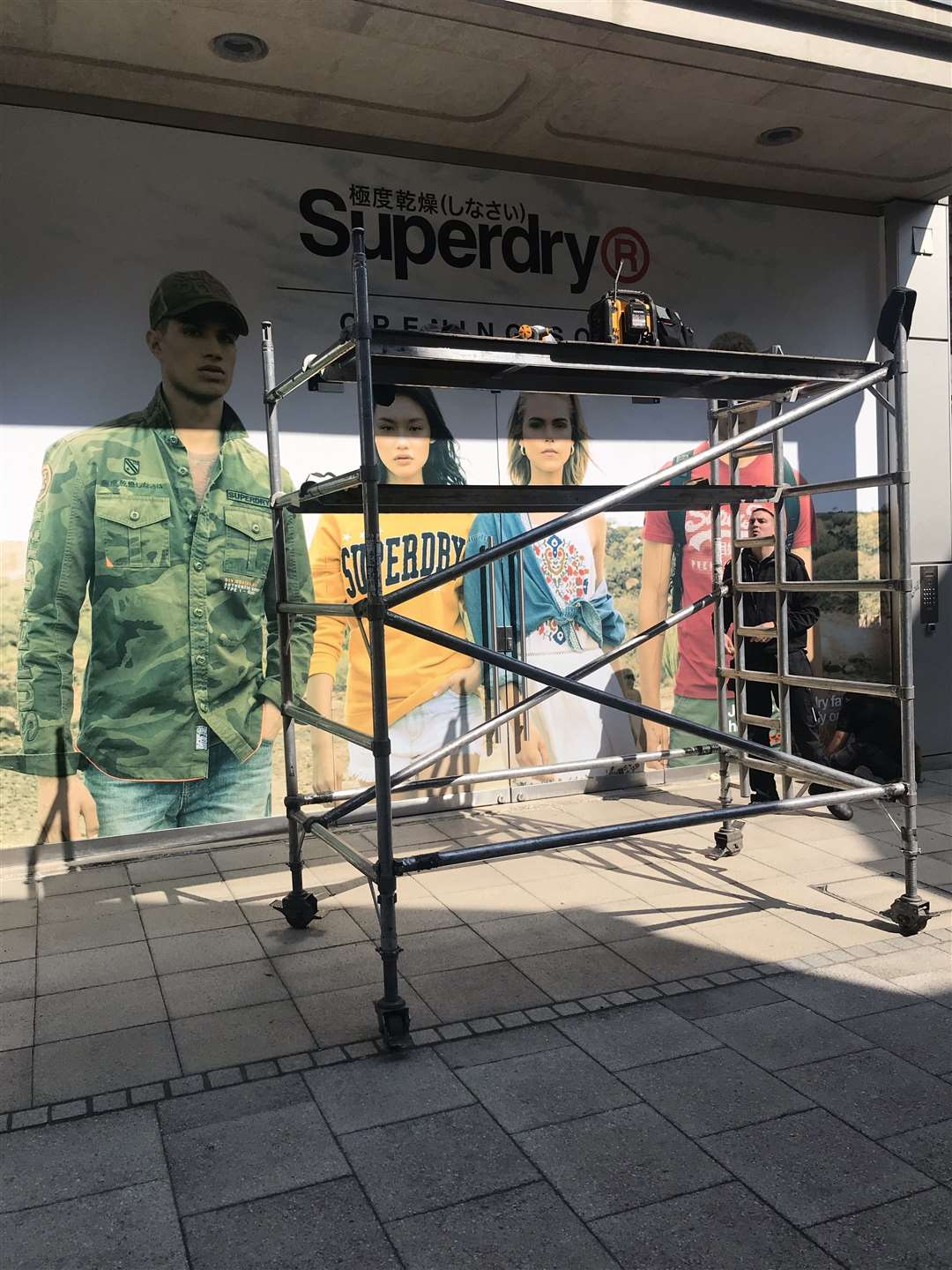 Superdry banner outside of the arc shopping centre.