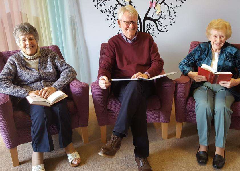 Cedrus House residents Jean Brown and Eileen Page with poet Alan Jones