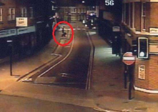 Luke Durbin search: a person in the distance, who appears to be walking a dog, in Dogs Head Street, Ipswich, close to the pedestrian crossing.