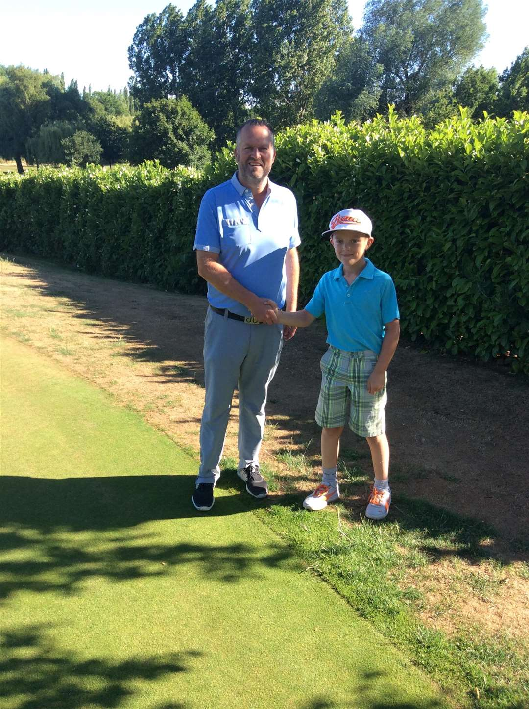 AMBITION: Haverhill GC pro Paul Wilby wishing fellow young member Ellis Kerr well ahead of the latter's participation in the 2018 IMG Academy Junior World Championships in San Diego