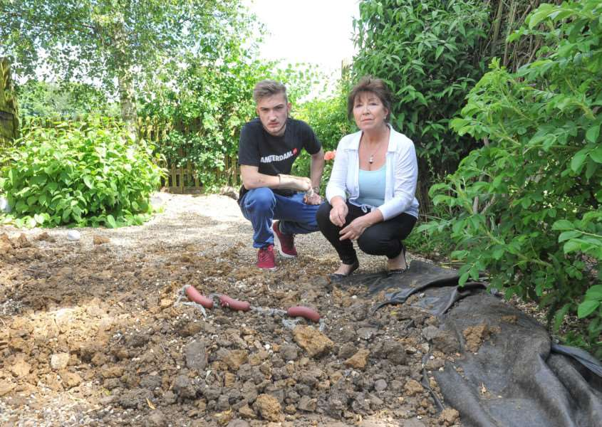 Deborah Stevens and son Thomas Stevens who have been left devastated after their dog was killed by neighbouring dogs. They are especially shocked at the lack of interest by police who failed to attend despite 18 calls. ANL-150806-203159009