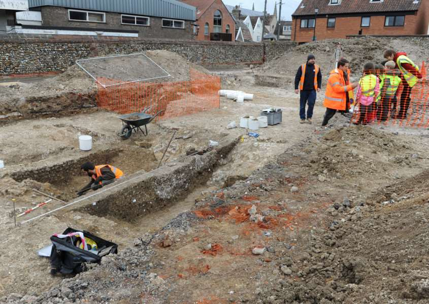 Archaeologists show pupils the excavation site at Guildhall Feoffment Primary School, in Bury
