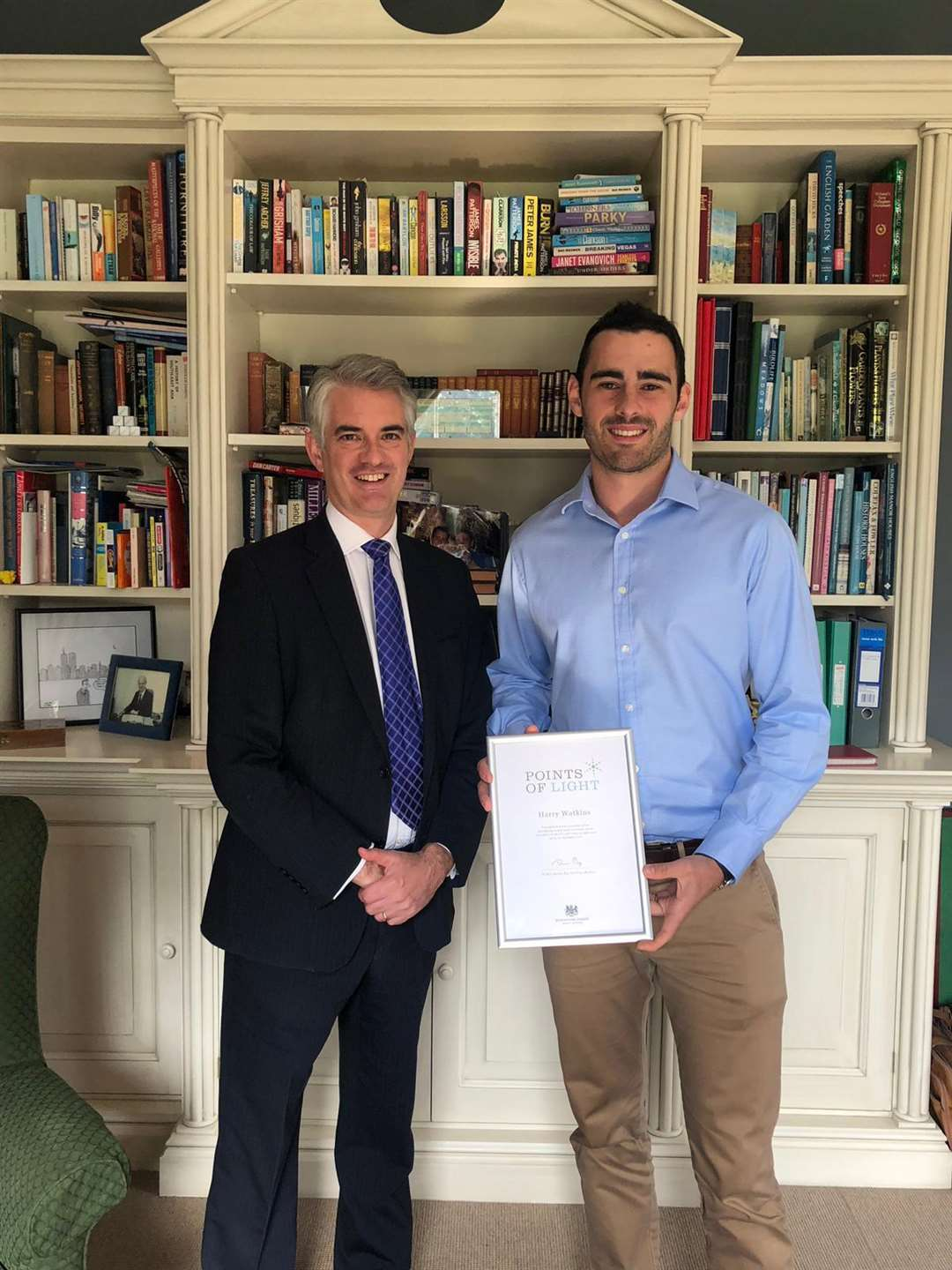 Higham resident Harry Watkins receives the Points of Light award for his work to champion mental health awareness. Pictured: Harry Watkins (right) with his local Member of Parliament, South Suffolk MP James Cartlidge. (4310130)
