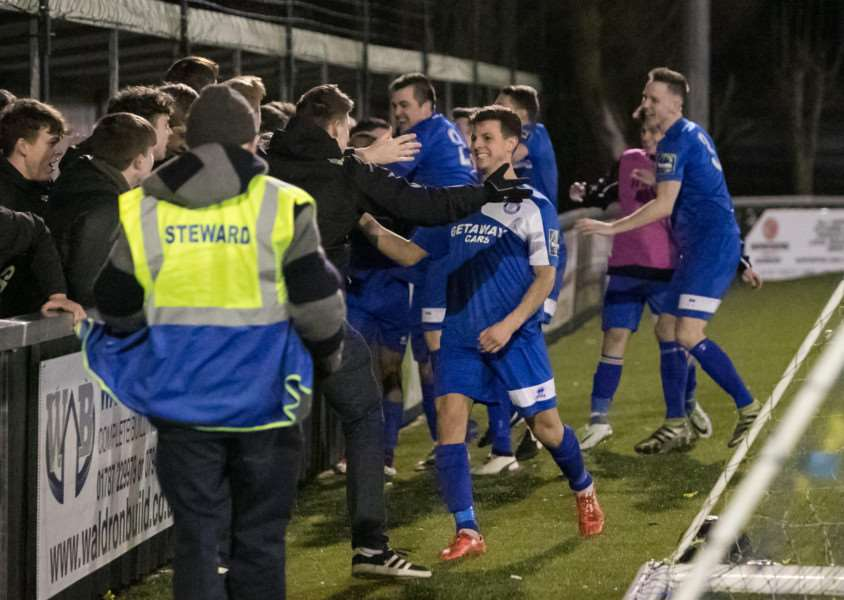 WINNING FEELING: Bury players and fans celebrate their victory. Picture: Paul Tebbutt